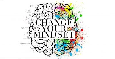 Drawing of brain, with 'Change your mindset' superimposed over it. The left side of the brain has figures and equations and symbols, the right side has splashes of colour.