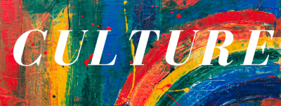 A rainbow painted background with the word 'Culture' in white