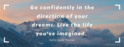 Text over a picture of mountains. Text says 'Go confidently in the direction of your dreams. Live the life you've imagined. Henry David Thoreau'